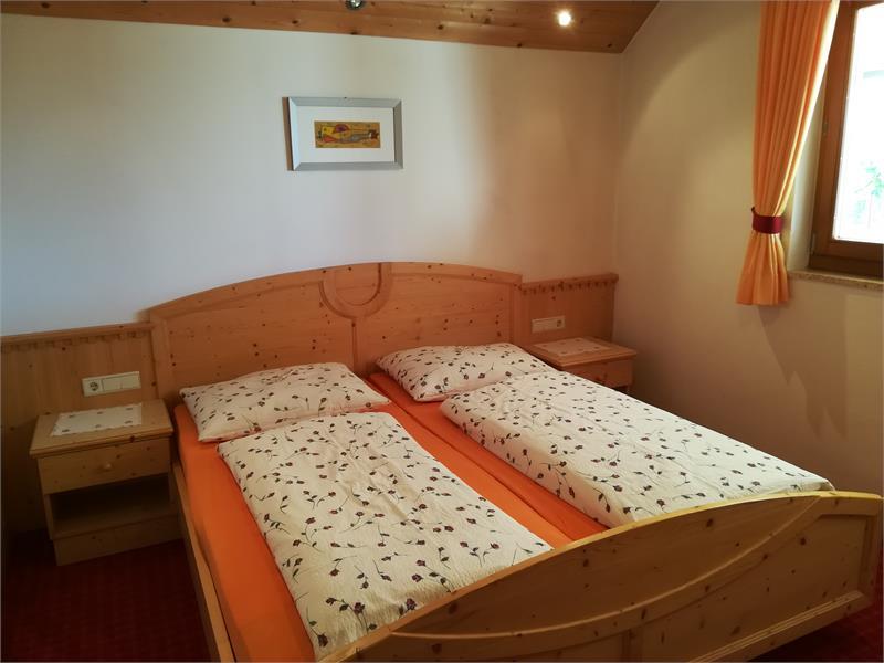 Camera da letto appartamento Stella Alpina