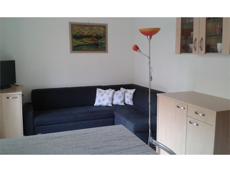 Salotto-cucina con divano letto
