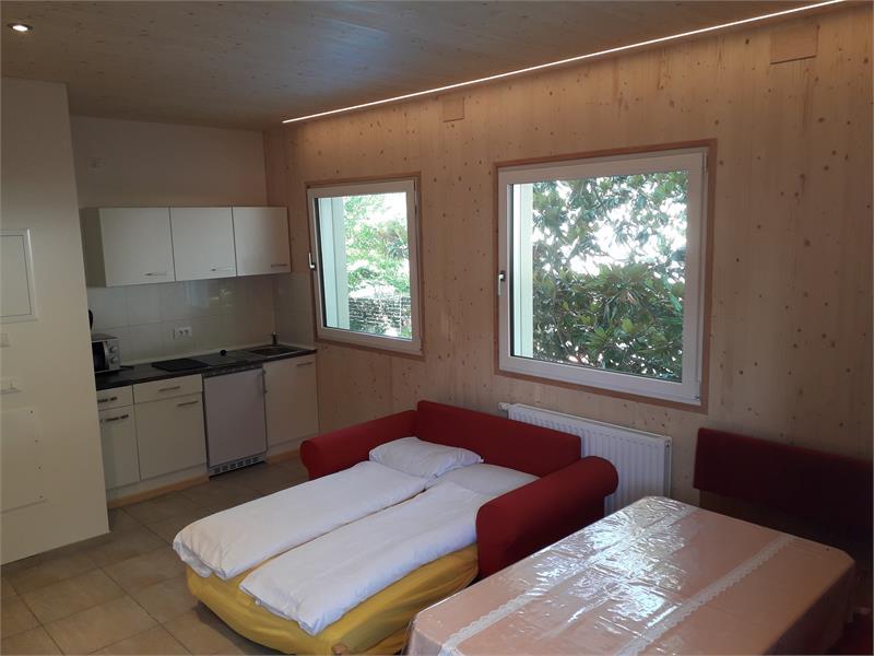 Cucina abitabile con divano letto