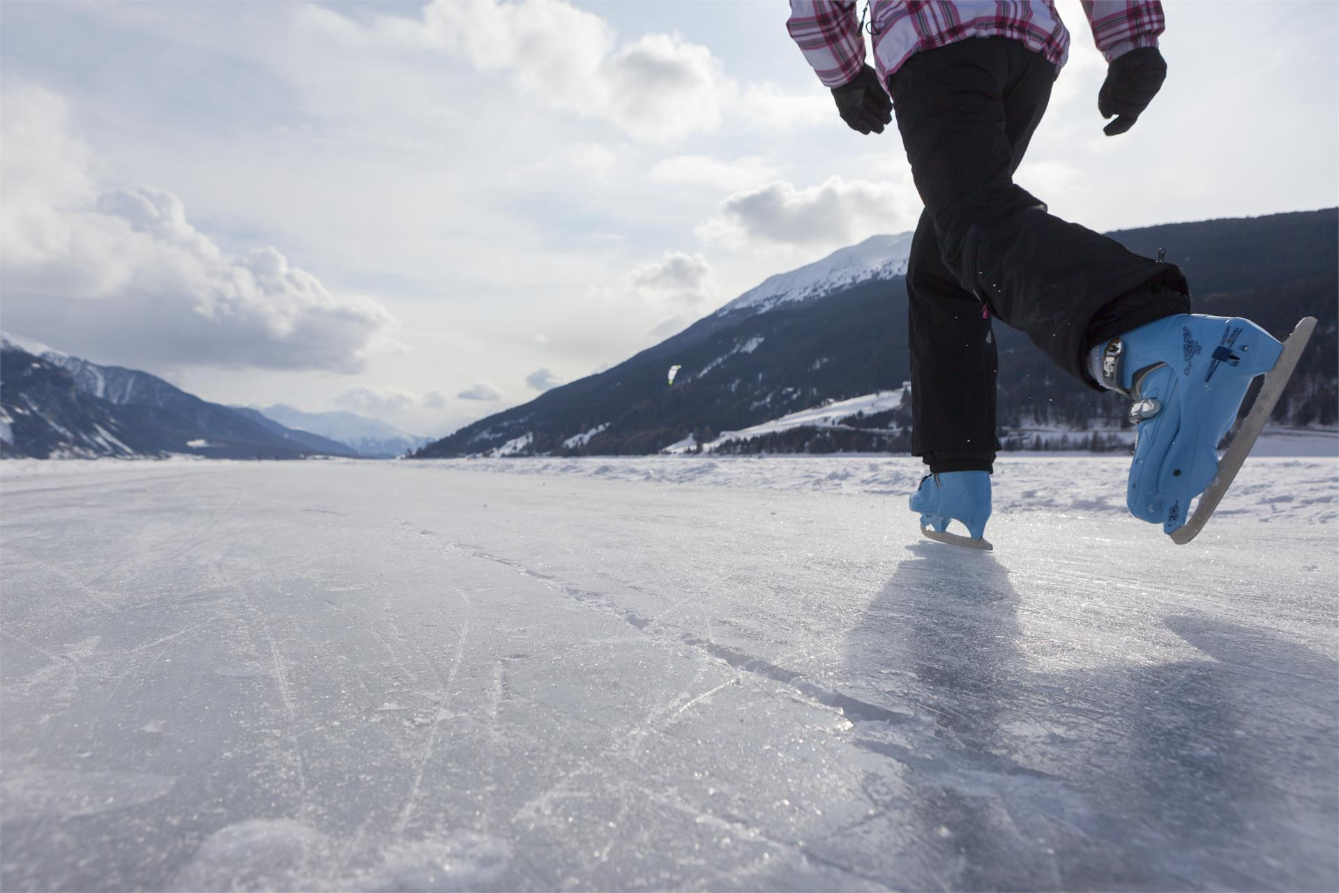 Ice skating on the lake Haidersee