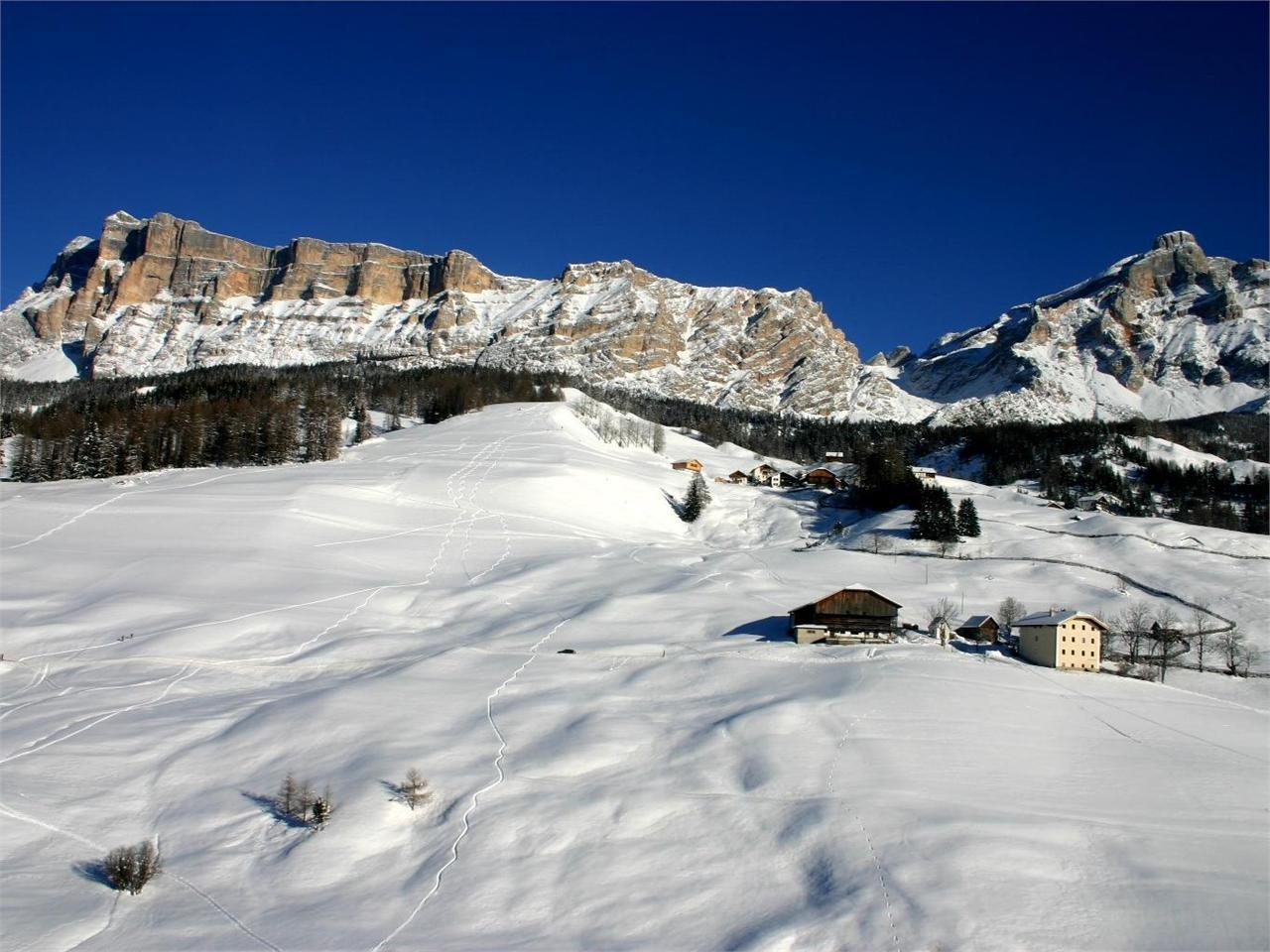 Winter hike through the farmland of Alta Badia
