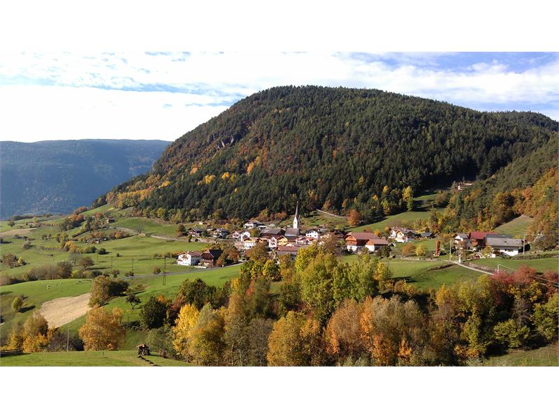 Beautiful autumn mood in Tisana near Castelrotto, in the foreground on the left the Paalhof farm