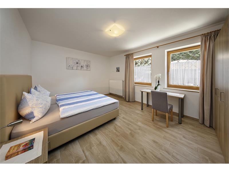 Gartenwohnung camera da letto