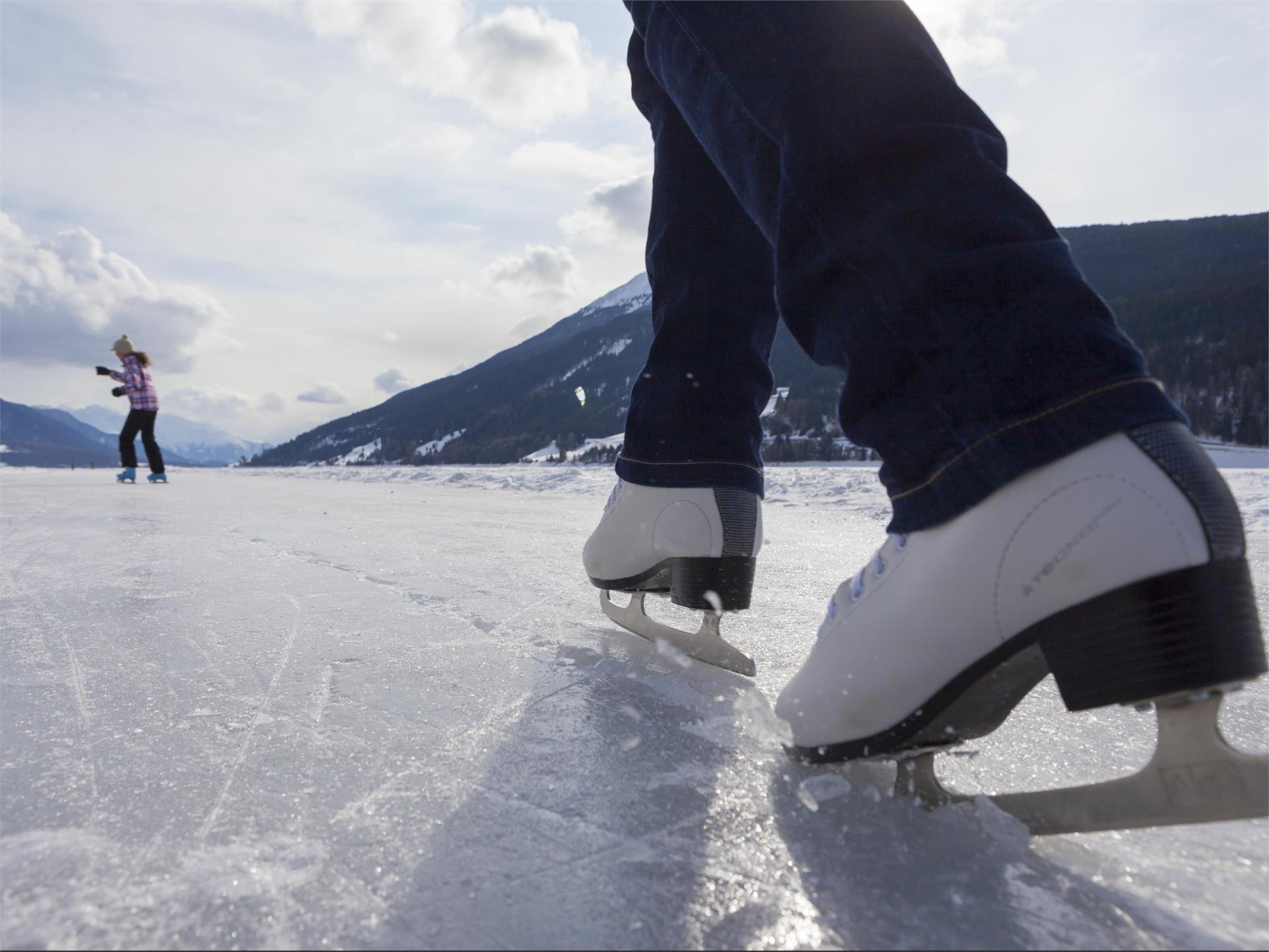 Ice skating on the lake Reschensee
