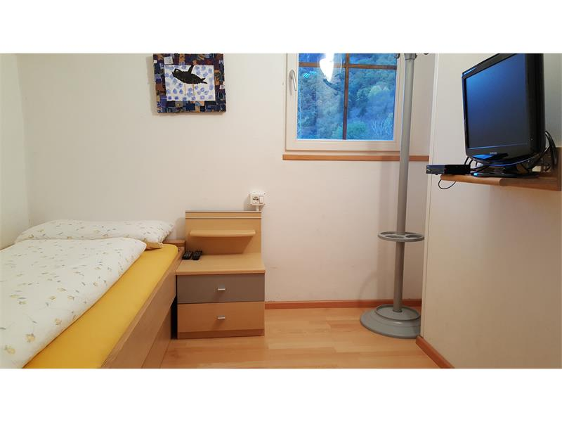 Camera da letto con letto singolo