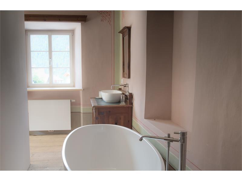 Room with bathtub