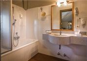 Bathroom with bathtub and shower