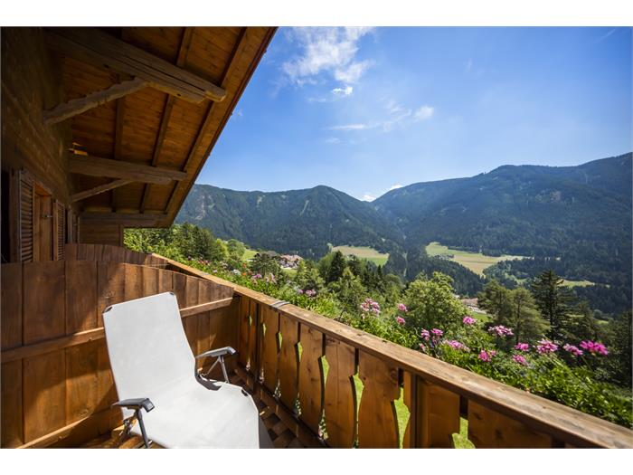 being relaxing deck chair in the balcony with marverllous valley look