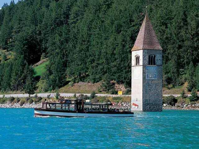 lake Reschensee with excursion boat