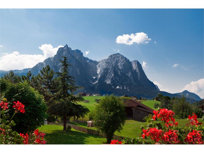 Aparthotel Viktoria Castelrotto Alpe di Siusi Dolomites south view in summer