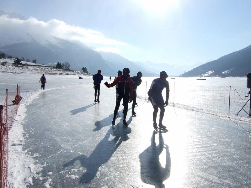 Ice skatin on the lake Reschensee